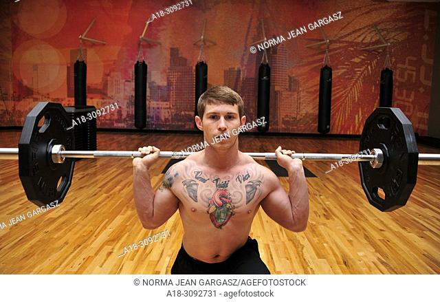 Strength training with weights in a gym, Marana, Arizona, USA