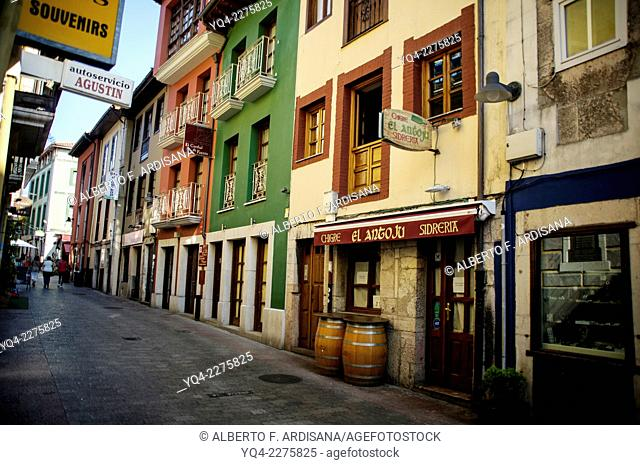 Typical streets of Llanes, with its colorful houses, Llanes, Asturias, Spain