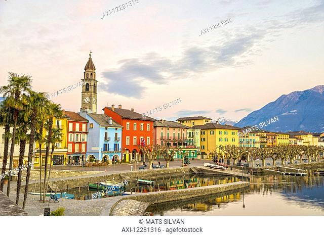Colourful buildings along the waterfront of Lake Maggiore; Ascona, Ticino, Switzerland