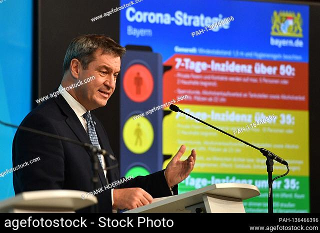 Markus SOEDER (Prime Minister of Bavaria and CSU Chairman) in front of a projection of the corona traffic light for Bavaria with the various incidence values