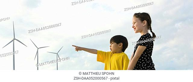 Children looking at wind turbines