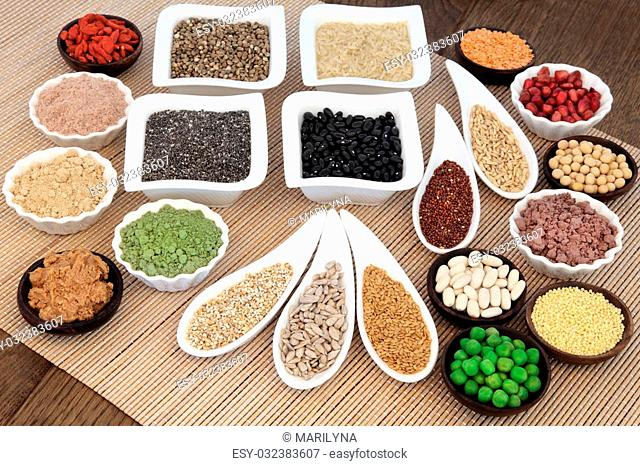 Health and body building super food with whey protein, wheat grass, acai berry and maca powder, nuts, seeds, pulses, grains, cereals, fruit