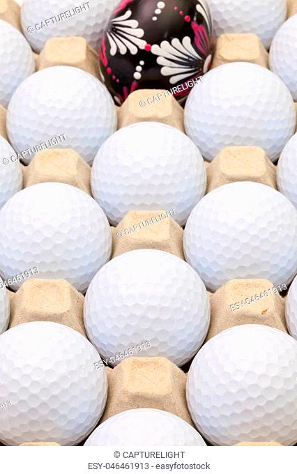 White golf balls in the box for eggs and Easter decoration