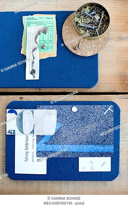DIY mood board made from cork mats with ticket, screws and nails