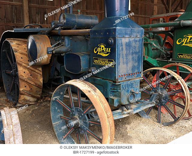 Antique Rumely Oil Pull tractor in a museum of agricultural equipment in Canada