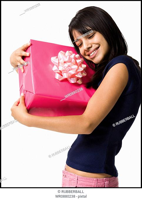 Close-up of a teenage girl holding a gift