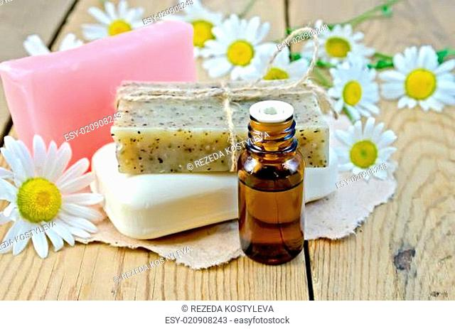 Oil with different soap and camomile on board