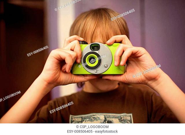 Boy with photo camera