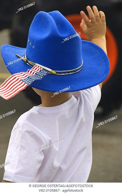 Young boy watching parade in cowboy hat, St Paul Rodeo Parade, St Paul, Oregon