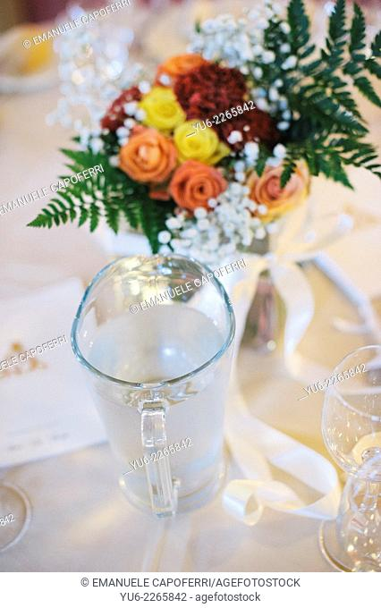 Center table with flowers and jug of water