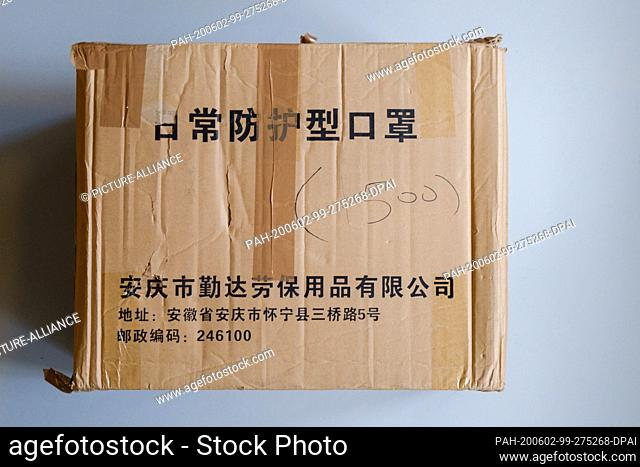 29 May 2020, Lower Saxony, Brunswick: A cardboard box of a protective mask delivery from China is in the National Museum