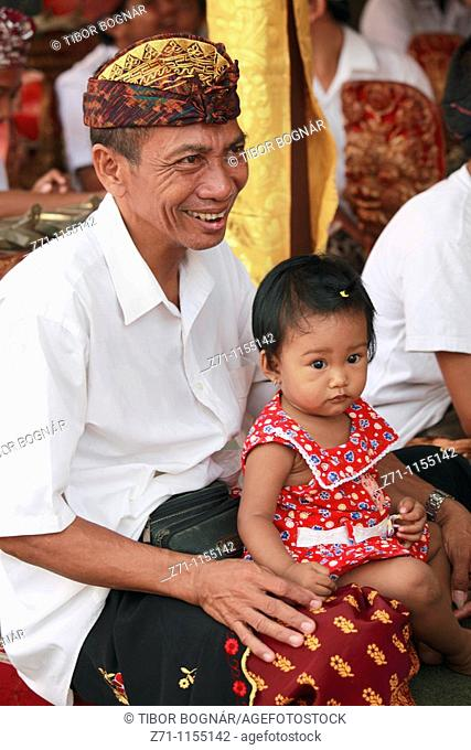 Indonesia, Bali, Mas, temple festival, people, odalan, Kuningan holiday, father with daughter