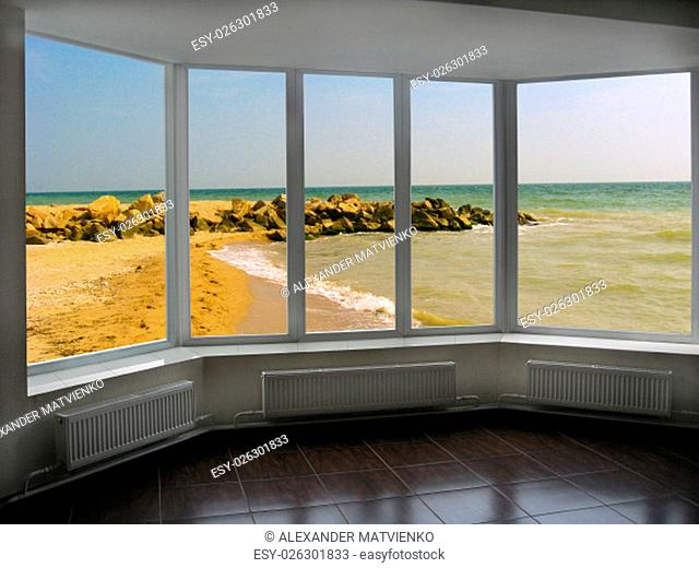 plastic window with beautiful view of marine waves sand and stones