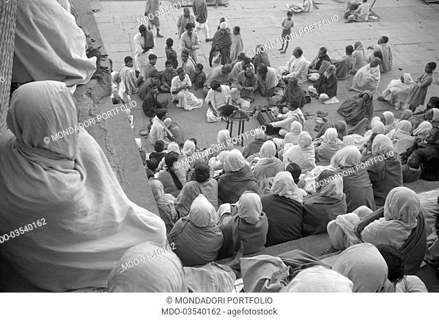 Some people listening to a street musician. Varanasi, 1965