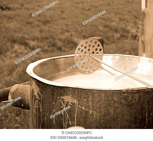 special tool to mix the rennet milk in the copper cauldron to produce the cheese