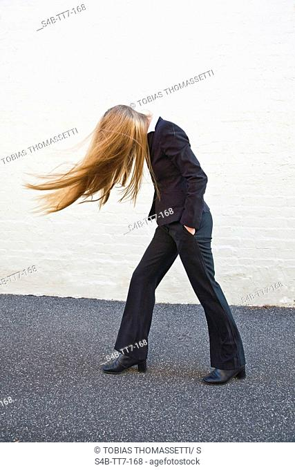 Young woman tossing her long hair, Melbourne, Victoria, Australia
