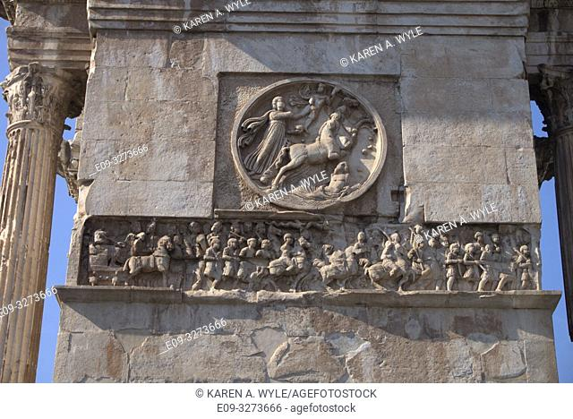 sculptural detail of Arch of Constantine (near Colosseum) including frieze, Rome, Italy