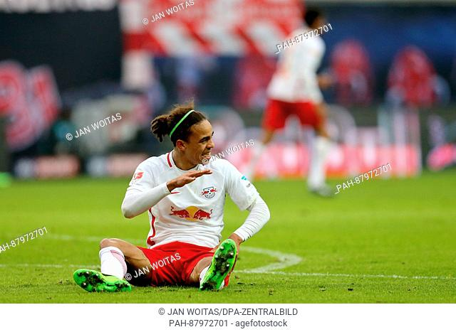Leipzig's Yussuf Poulsen sits on the ground after getting injured during the Bundesliga soccer match between RB Leipzig and Hamburger SV at the Red Bull Arena...