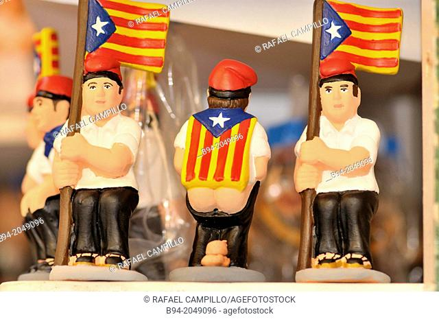 Caganers, typical Catalan figures, with indenpedentist flags, for Christmas decoration, Barcelona, Catalonia, Spain