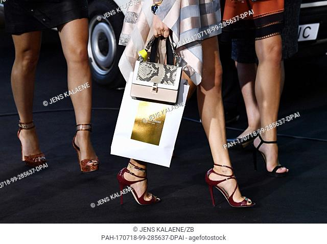 Guests with Bucherer gift bags arrive at the world premiere of the American spy action thriller 'Atomic Blonde' in Berlin, Germany, 17 July 2017