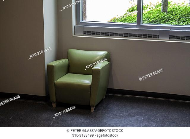 Soft chair by a window in an office building lobby