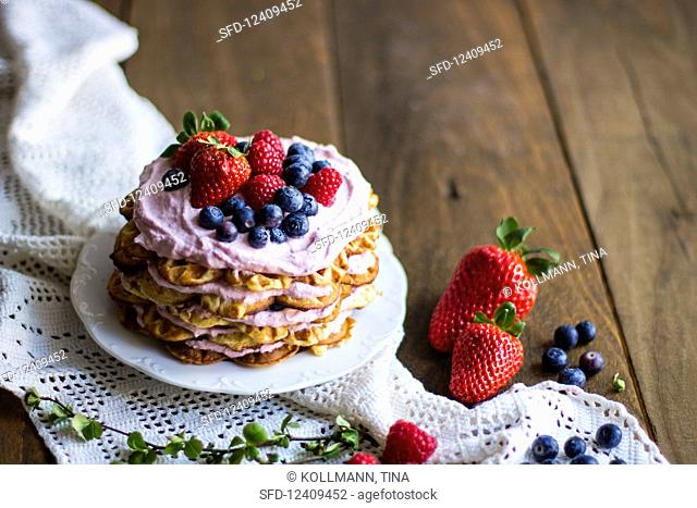 Waffle cake with red berries