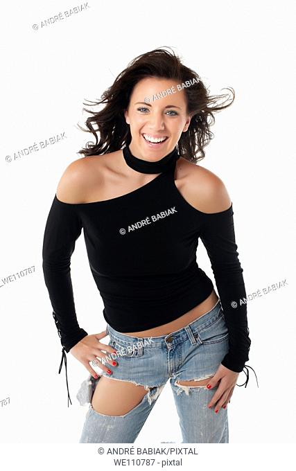 Smiling woman in casual teenager outfit