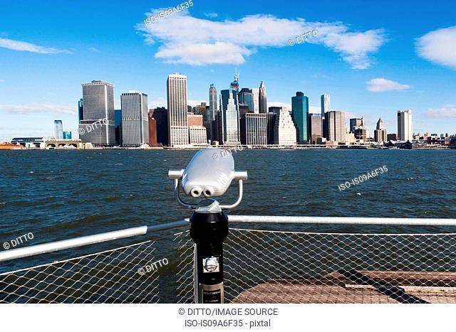 Coin operated binoculars view Manhattan skyline, New York City, USA