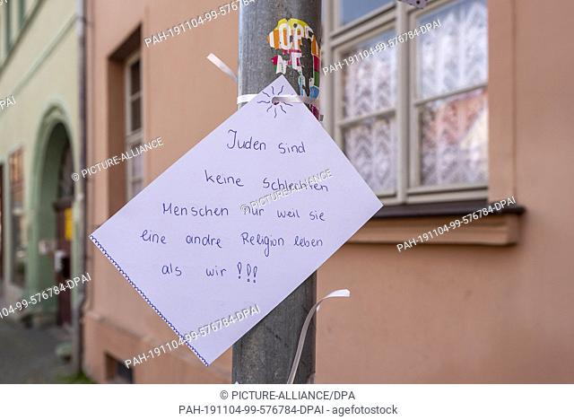 24 October 2019, Saxony-Anhalt, Eisleben: In front of the synagogue in Eisleben, residents have posted posters with messages against anti-Semitism and hostility...