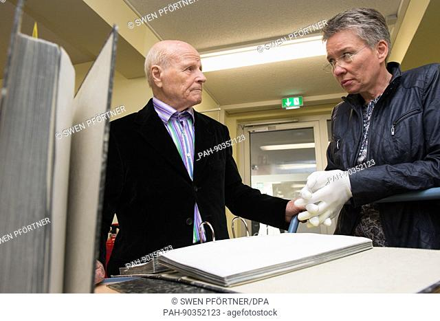Former concentration camp inmate Alexandr Afanasyev talks to archivist Nicole Dominicus (R) in the International Tracing Service (ITS) archive in Bad Arolsen
