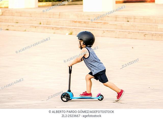 child skating in Valencia, Spain