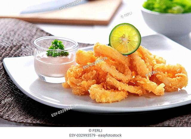 fried calamary served with a cocktail sauce