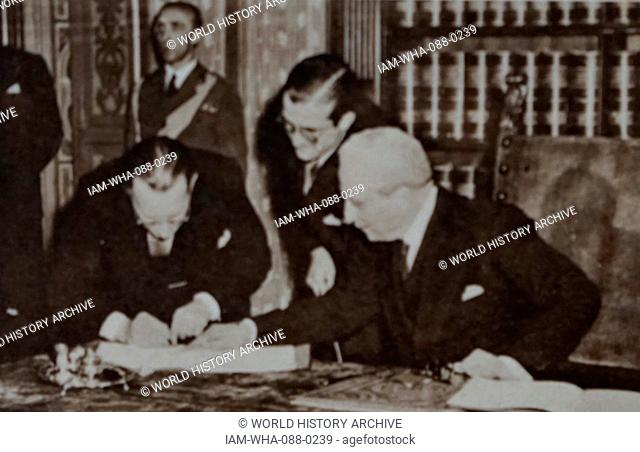Photograph of the signing of the New Italian Constitution. Pictured is Alcide De Gasperi (1881-1954) and Enrico De Nicola (1877-1959)