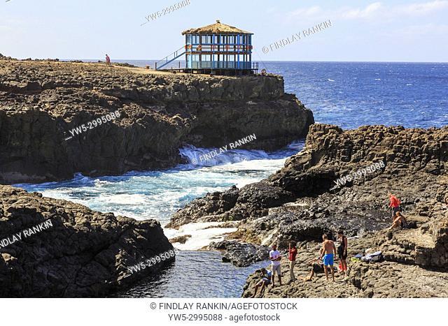 Naturally occurring swimming pool in the rocks at Baracona, near Terra Boa, Sal Island, Salinas, Cape Verde, Africa