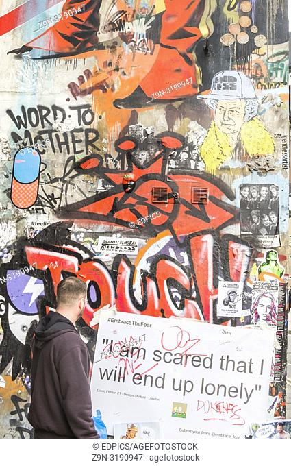"""street art collage, man looking at the sentence """"""""I'm scared that I will end up lonely"""""""", london, england"""