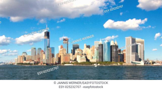 Blurred background of One World Trade Center under construction in the NYC skyline in September 2012
