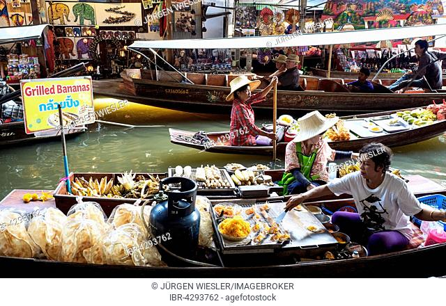 Floating Market with boats and sellers on a canal or Khlong, Damnoen Saduak, Ratchaburi Province, Thailand