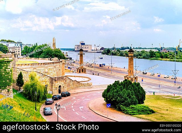 View from Rampart of Brave and promenade on Old Town quay in Szczecin docklands with Odra River, rustic dock cranes and harbour in background