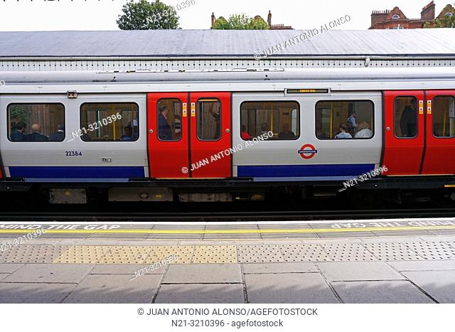 A District Line tube train at West Kensington Station. London, England, Great Britain, Europe