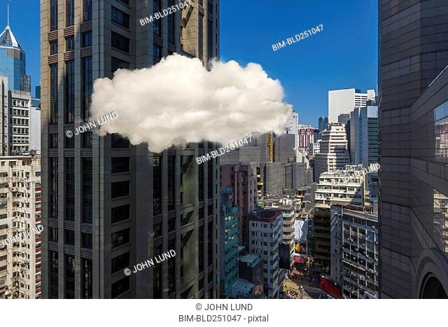 Cloud hovering in city