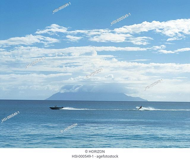 Travel, Seychelles, Coast view with water skier
