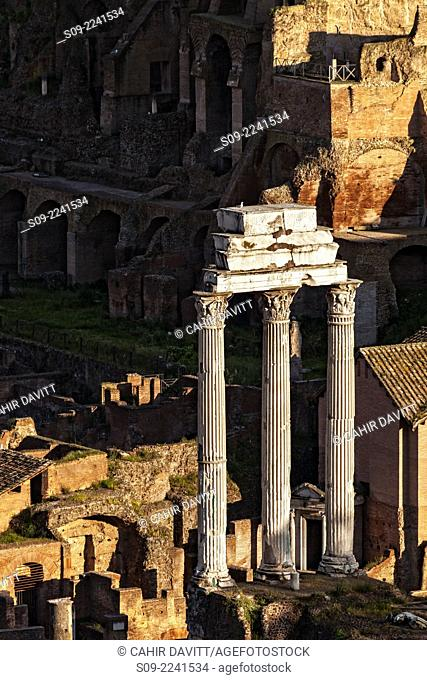 The three standing columns of Castor and Pollux in the Roman Forum at sunset, Centro Storico, Rome, Lazio, Italy