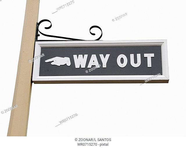 vintage way out sign on wooden post isolated on white background