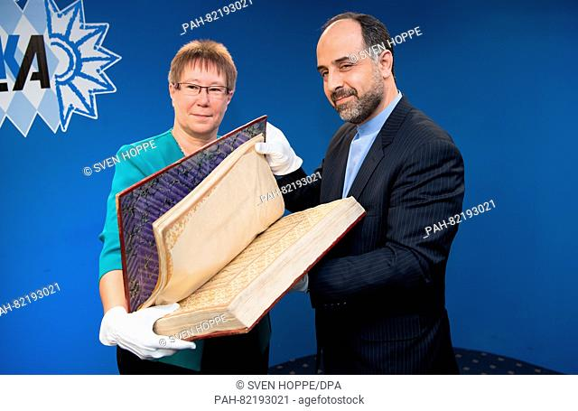 Petra Sandles, vice president of the Bavarian State Office of Criminal Investigations (LKA), hands a Quran from northern India (ca