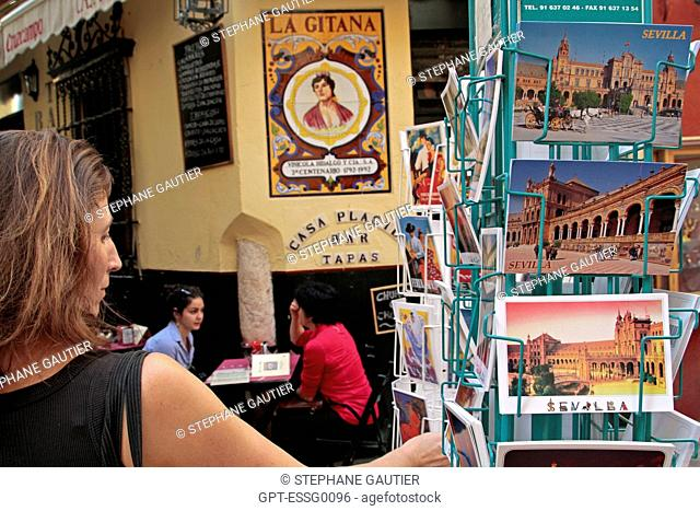 POSTCARDS IN FRONT OF THE TAPAS BAR, LA CASA PLACIDO, SEVILLE, ANDALUSIA, SPAIN