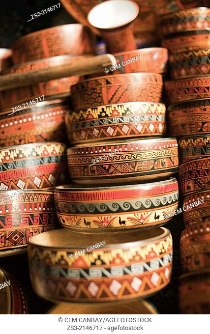 Close-up shot of wooden bowls at the open-air market in Pisaq, Sacred Valley, Cuzco Region, Peru, South America