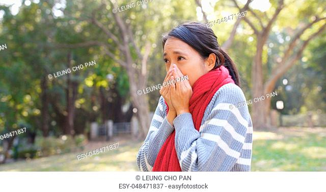 Woman feeling so cold at outdoor at winter time