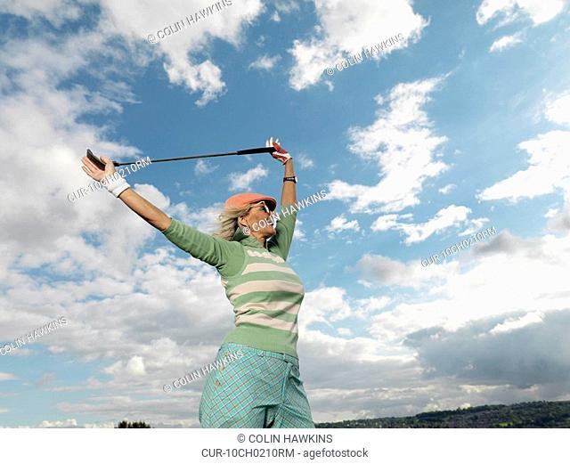 Mature lady preparing to playing golf