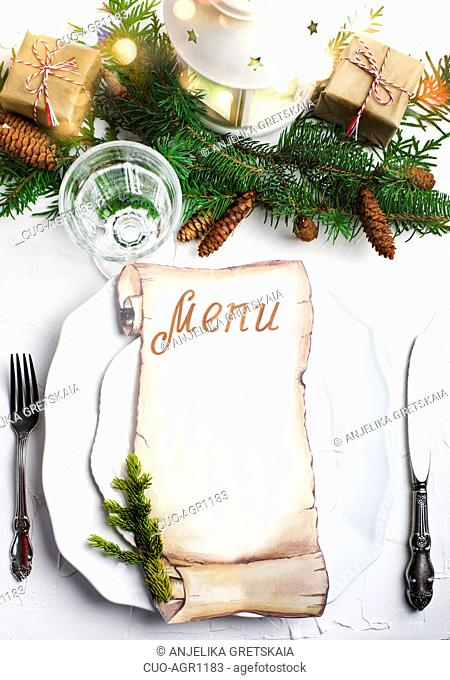 Christmas place setting with blank paper for writing the Christmas menu, top view, copy space