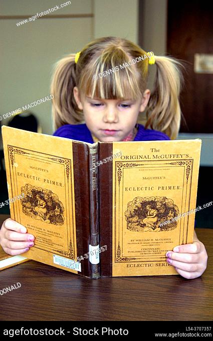 Child reading the Origianl McGuffey Ecletic Primer